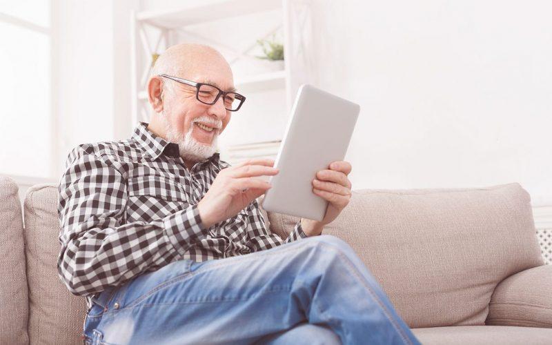 Senior using tabled
