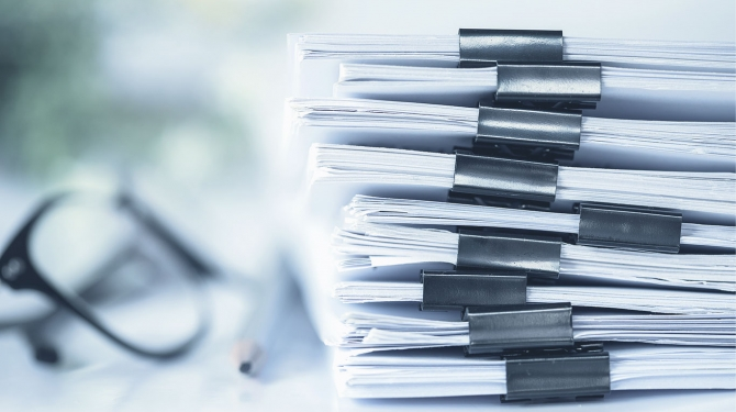 Stack of clippled documents