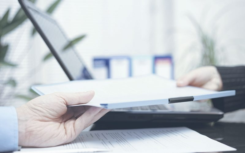 Person handing papers