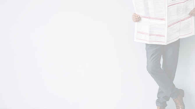 Person holding newspaper